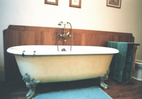 A bathtub in an old bedroom!