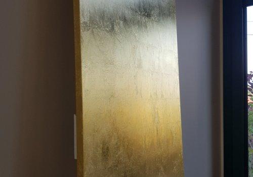 Feuilles d'or sur panneaux
